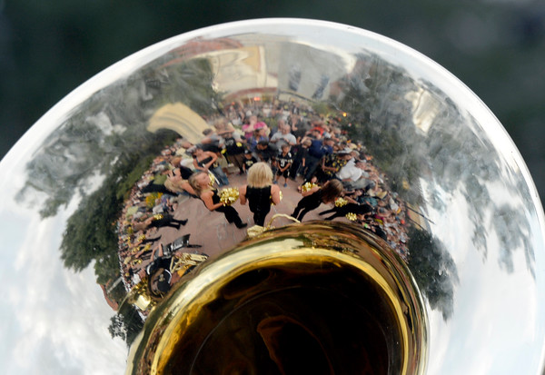 """University of Colorado Gold Rush Dance Team members and the crowd are reflected in a tuba on Friday, Aug. 31, during the CU pep rally on Pearl Street in Boulder. For more photos and video of the pep rally go to  <a href=""""http://www.dailycamera.com"""">http://www.dailycamera.com</a><br /> Jeremy Papasso/ Camera"""