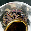 "University of Colorado Gold Rush Dance Team members and the crowd are reflected in a tuba on Friday, Aug. 31, during the CU pep rally on Pearl Street in Boulder. For more photos and video of the pep rally go to  <a href=""http://www.dailycamera.com"">http://www.dailycamera.com</a><br /> Jeremy Papasso/ Camera"