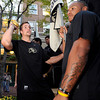 "University of Colorado football players Tommy Papilion, left, throws a football to a fan while standing next to teammate Davaughn Thornton, right, on Friday, Aug. 31, during the CU pep rally on Pearl Street in Boulder. For more photos and video of the pep rally go to  <a href=""http://www.dailycamera.com"">http://www.dailycamera.com</a><br /> Jeremy Papasso/ Camera"