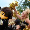 "University of Colorado Gold Rush Dance Team member Megan Moran performs for the crowd next to Chip on Friday, Aug. 31, during the CU pep rally on Pearl Street in Boulder. For more photos and video of the pep rally go to  <a href=""http://www.dailycamera.com"">http://www.dailycamera.com</a><br /> Jeremy Papasso/ Camera"