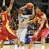 CUIOWA<br /> CU's Shannon Sharpe looks to pass while under pressure from <br /> Darion Anderson, left, and Diante Garrett of Iowa State.<br /> Photo by Marty Caivano/Feb.1, 2011