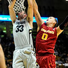 CUIOWA<br /> CU's Austin Dufault goes up against Jordan Railey of Iowa State.<br /> Photo by Marty Caivano/Feb.1, 2011