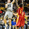 CUIOWA<br /> CU's Levi Knutson sinks a left-hander over Bubu Palo of Iowa State.<br /> Photo by Marty Caivano/Feb.1, 2011