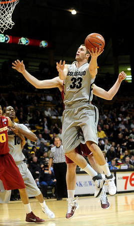 CUIOWA<br /> CU's Austin Dufault sinks a shot against Iowa State.<br /> Photo by Marty Caivano/Feb.1, 2011