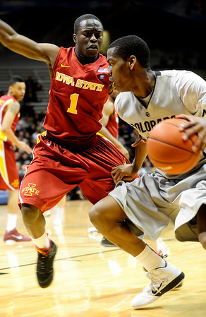 CUIOWA<br /> CU's Alec Burks drives past Bubu Palo of Iowa State.<br /> Photo by Marty Caivano/Feb.1, 2011