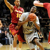 CUIOWA<br /> CU's Alec Burks collides with Diante Garrett of Iowa State.<br /> Photo by Marty Caivano/Feb.1, 2011