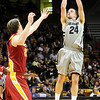 CUIOWA<br /> CU's Levi Knutson sinks a three-point shot against Iowa State.<br /> Photo by Marty Caivano/Feb.1, 2011