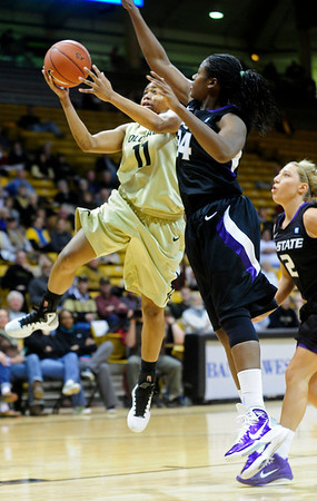 CUKANSAS<br /> CU's Brittany Wilson sinks a shot despite pressure from Branshea Brown of Kansas State.<br /> Photo by Marty Caivano/Jan. 26, 2011
