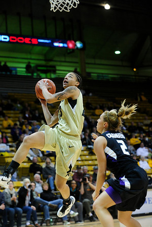 CUKANSAS<br /> CU's Chucky Jeffery jumps past Brittany Chambers of Kansas State.<br /> Photo by Marty Caivano/Jan. 26, 2011