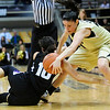 CUKANSAS<br /> CU's Chelsea Dale fights for a loose ball against Kelsey Hill of Kansas State.<br /> Photo by Marty Caivano/Jan. 26, 2011