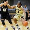 CUKANSAS<br /> CU's Britney Blythe fends off Kelsey Hill of Kansas State as she drives to the basket.<br /> Photo by Marty Caivano/Jan. 26, 2011