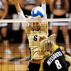 Colorado's Kerra Schroeder blocks a shot from Missouri's Lisa Henning during their volleyball game at the University of Colorado in Boulder, Colorado November 3, 2010. CAMERA/Mark Leffingwell