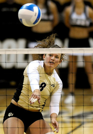 Colorado's Richi Bigelow spikes the ball over the net against  Missouri during their volleyball game at the University of Colorado in Boulder, Colorado November 3, 2010. CAMERA/Mark Leffingwell