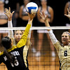 Colorado's Nikki Lindow (left) and Kerra Schroeder (right) block a shot from Missouri's Catie Wilson during their volleyball game at the University of Colorado in Boulder, Colorado November 3, 2010. CAMERA/Mark Leffingwell