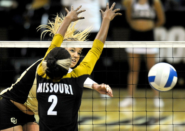 Colorado's Nikki Lindow hammers the ball past Missouri's Brittney Brimmage during their volleyball game at the University of Colorado in Boulder, Colorado November 3, 2010. CAMERA/Mark Leffingwell