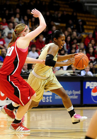 CUNEB<br /> CU's Britney Blythe is pressured by Lindsey Moore of Nebraska.<br /> Photo by Marty Caivano/Feb. 6, 2011