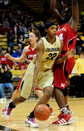 CUNEB<br /> CU's Brittany Spears drives past Catheryn Redmon of Nebraska.<br /> Photo by Marty Caivano/Feb. 6, 2011