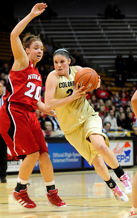 CUNEB<br /> CU's Chelsea Dale pushes past Katya Leick of Nebraska.<br /> Photo by Marty Caivano/Feb. 6, 2011