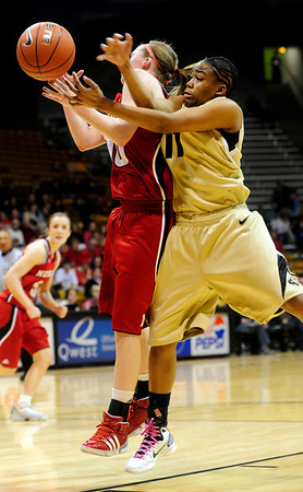 CUNEB<br /> CU's Brittany Wilson collides with Lindsey Moore of Nebraska.<br /> Photo by Marty Caivano/Feb. 6, 2011