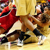 CUNEB<br /> CU's Brittany Wilson fights for the ball against Jordan Hooper of Nebraska.<br /> Photo by Marty Caivano/Feb. 6, 2011