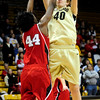 CUNEB<br /> CU's Rachel Hargis shoots over Catheryn Redmon of Nebraska.<br /> Photo by Marty Caivano/Feb. 6, 2011