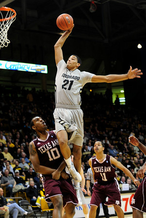 CUTEXAS<br /> CU's Andre Roberson sinks a dunk over David Loubeau of Texas A&M.<br /> Photo by Marty Caivano/Feb. 9, 2011