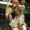 CUTEX<br /> CU's Shannon Sharpe grabs a rebound away from Matt Mierzycki of Texas-Pan American.<br /> Photo by Marty Caivano/Camera/Nov. 30, 2010