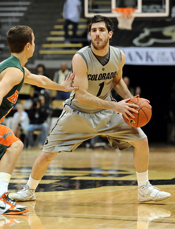 CUTEX<br /> CU's Nate Tomlinson looks to pass while being guarded by Aaron Urbanus of Texas-Pan American.<br /> Photo by Marty Caivano/Camera/Nov. 30, 2010