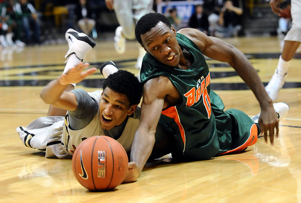 CUTEX<br /> CU's Andre Roberson and Brandon Provost of Texas-Pan American dive for a loose ball.<br /> Photo by Marty Caivano/Camera/Nov. 30, 2010