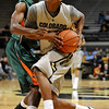 CUTEX<br /> CU's Alec Burks drives past Brandon Provost of Texas-Pan American.<br /> Photo by Marty Caivano/Camera/Nov. 30, 2010