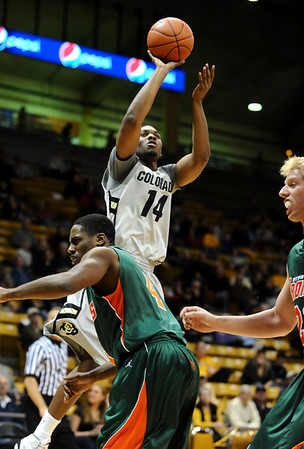 CUTEX<br /> CU's Javon Coney shoots over Julius Hearn of Texas-Pan American.<br /> Photo by Marty Caivano/Camera/Nov. 30, 2010