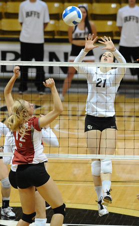 VOLLEY<br /> CU's Lydia Blaha jumps to block against Chelsey Bettinson of Washington State.<br /> <br /> <br /> PHOTO BY MARTY CAIVANO<br /> Nov. 18, 2011