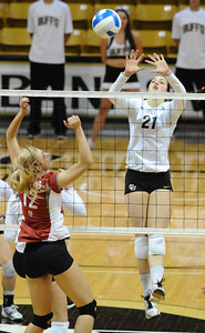 VOLLEY CU's Lydia Blaha jumps to block against Chelsey Bettinson of Washington State.   PHOTO BY MARTY CAIVANO Nov. 18, 2011