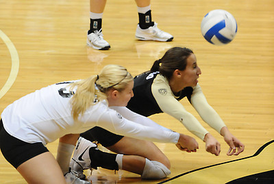 VOLLEY CU's Jessica Aschenbrenner, left and Megan Beckwith, both dive for a ball against Washington State.    PHOTO BY MARTY CAIVANO Nov. 18, 2011