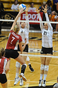 VOLLEY CU's Kelsey English and Lydia Blaha jump to block against Rachel Todorovich of Washington State.   PHOTO BY MARTY CAIVANO Nov. 18, 2011