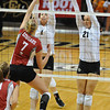 VOLLEY<br /> CU's Kelsey English and Lydia Blaha jump to block against Rachel Todorovich of Washington State.<br /> <br /> <br /> PHOTO BY MARTY CAIVANO<br /> Nov. 18, 2011