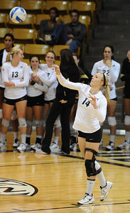 VOLLEY CU's Emily Alexis serves against Washington State.   PHOTO BY MARTY CAIVANO Nov. 18, 2011