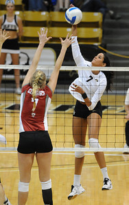 VOLLEY CU's Neira Ortiz Ruiz drives the ball past Rachel Todorovich of Washington State.   PHOTO BY MARTY CAIVANO Nov. 18, 2011