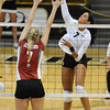 VOLLEY<br /> CU's Neira Ortiz Ruiz drives the ball past Rachel Todorovich of Washington State.<br /> <br /> <br /> PHOTO BY MARTY CAIVANO<br /> Nov. 18, 2011