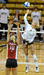 VOLLEY CU's Kerra Schroeder spikes the ball against Marcelina Glab of Washington State.   PHOTO BY MARTY CAIVANO Nov. 18, 2011