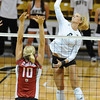 VOLLEY<br /> CU's Kerra Schroeder spikes the ball against Marcelina Glab of Washington State.<br /> <br /> <br /> PHOTO BY MARTY CAIVANO<br /> Nov. 18, 2011