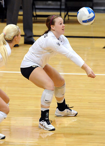 VOLLEY CU's Hannah Walker puts up the ball against Washington State.   PHOTO BY MARTY CAIVANO Nov. 18, 2011