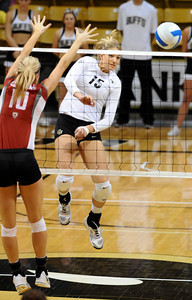 VOLLEY CU's Nikki Lindow spikes the ball past Marcelina Glab of Washington State.   PHOTO BY MARTY CAIVANO Nov. 18, 2011