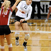 VOLLEY<br /> CU's Nikki Lindow spikes the ball past Marcelina Glab of Washington State.<br /> <br /> <br /> PHOTO BY MARTY CAIVANO<br /> Nov. 18, 2011