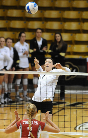 VOLLEY<br /> CU's Kelsey English jumps to drive the ball past Rachel Todorovich of Washington State.<br /> <br /> <br /> PHOTO BY MARTY CAIVANO<br /> Nov. 18, 2011