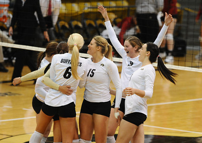 VOLLEY CU's volleyball team celebrates a match win against Washington State.   PHOTO BY MARTY CAIVANO Nov. 18, 2011