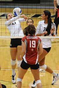 VOLLEY CU's Lydia Blaha tries to save an awkward ball tipped her way against Washington State. At right is Neira Ortiz Ruiz.   PHOTO BY MARTY CAIVANO Nov. 18, 2011
