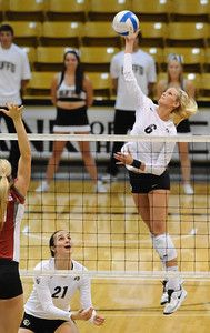 VOLLEY CU's Kerra Schroeder spikes the ball against Washington State.   PHOTO BY MARTY CAIVANO Nov. 18, 2011