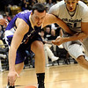 CU<br /> CU's Andre Roberson fights to gain a loose ball from Chuck Kempf of Western New Mexico.<br /> Photo by Marty Caivano/Jan. 5, 2010