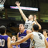 CU<br /> CU's Austin Dufault gets up a shot against Western New Mexico.<br /> Photo by Marty Caivano/Jan. 5, 2010